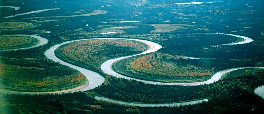 The meandering channel of the Nowitna River, Alaska. Numerous oxbow lakes are present and another meander cutoff will soon take place. [Oliver Kumis CC-BY-SA http://bit.ly/1SmQL7B]