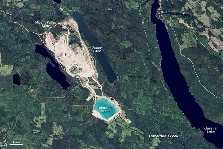 "Figure 20.14a The Mt. Polley Mine area prior to the dam breach of August 2014. The tailings were stored in the area labelled ""retention basin."" [https://en.wikipedia.org/wiki/Mount_Polley_mine_disaster]"