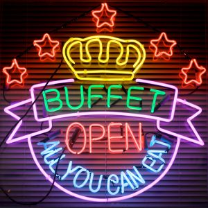 "A neon sign advertises an all-you-can-eat buffet."" title=""A neon sign advertises an all-you-can-eat buffet."
