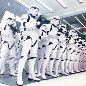 A line of identically dressed Storm Troopers from the Star Wars films.