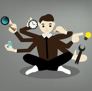 Illustration of a man with six arms doing six tasks simultaneously.