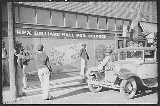 "The store front of a billiard hall called, ""Rex Billiard Hall for Colored"""