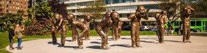 14 bronze statues standing 3 meters tall express different states of laughter.